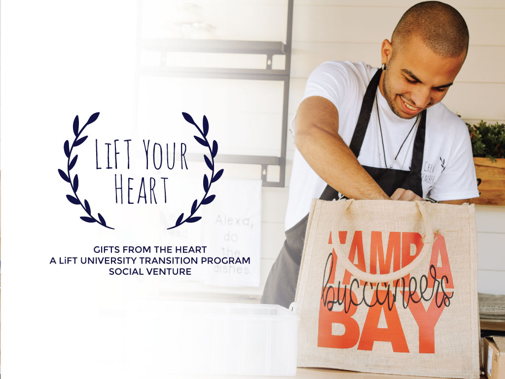 LiFT Your Heart Male Boy Employee Team Member loading canvas bag with red text Tampa Bay